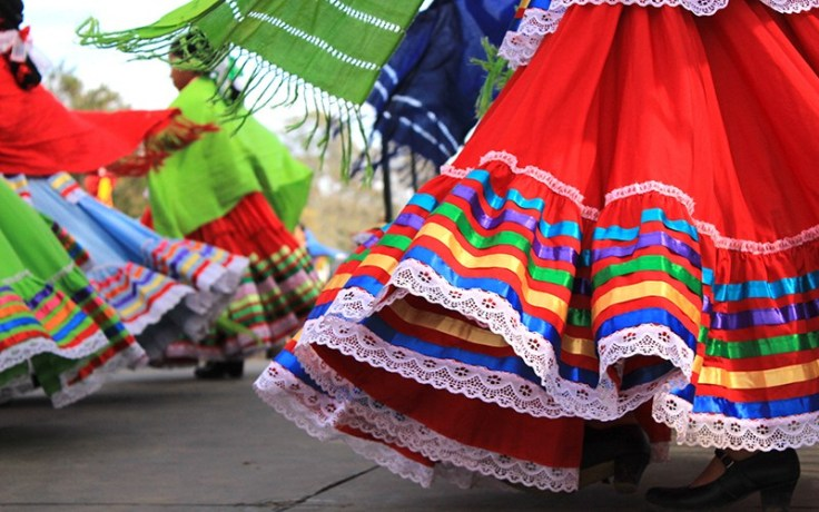 Colorful skirts moving with the dancers in the Mexican tradition called the Mexican hat dance