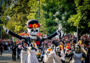 MEXICO CITY, MEXICO - OCTOBER 29, 2016 : Day of the dead parade 2016 in Mexico City credit shutterstock